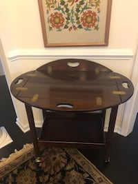 Wooden bar cart/ movable tray top. Very good condition.
