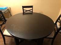 Round hardwood table with four chairs dining set 66 km