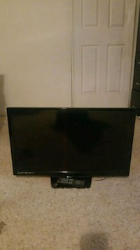 """black flat screen TV 28"""" with remote"""