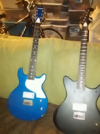 two blue and white electric guitars Corona, 92879