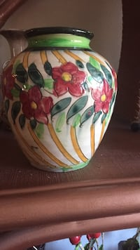 White, red, green, and yellow ceramic floral pot
