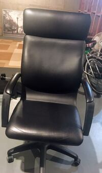 Black leather padded rolling armchair Calgary, T2A 0E6