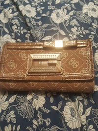 It a brown guess wallet Edmonton, T5C 0S8