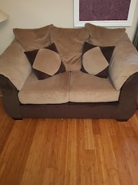 brown and black fabric loveseat null