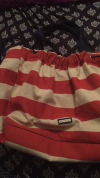 red and white striped fabric tote bag