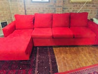 Red fabric sectional sofa with throw pillows Toronto, M2N 2L5