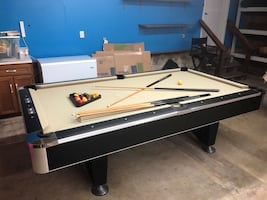 Pool Table with cues and balls
