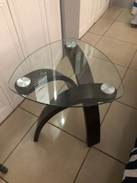 round glass top table with black wooden base Miami, 33131