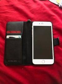 Rose gold iPhone 6 Plus with Michael kors black case