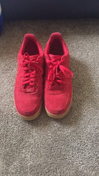 Pair of red nike running shoes Fallbrook, 92058