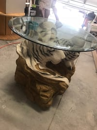glass top coffee table with brown wooden base Kissimmee, 34743