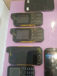 three black candybar phones and two black smartphones Montréal, H1H 4T6