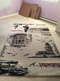 White and black printed area rug