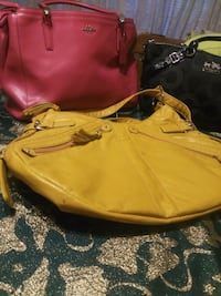 yellow and black leather bag 474 mi