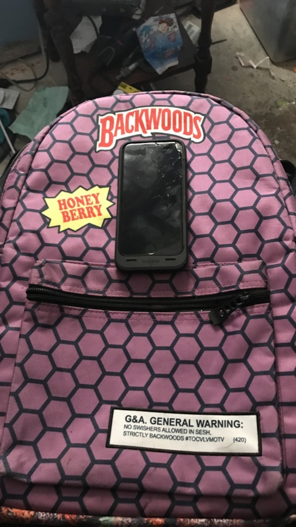 Used Purple and black backwoods backpack for sale in