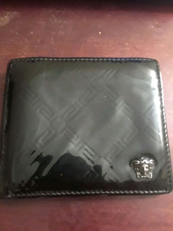 black leather dual-fold wallet