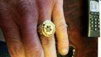 gold-colored Toronto Maple Leafs ring