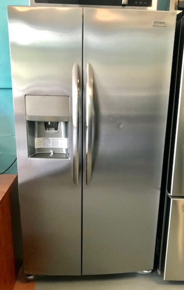 New Frigidaire stainless steel side by side fridge
