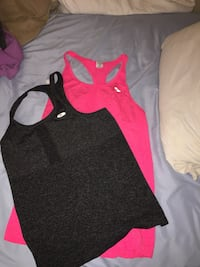 Two black and pink racerback tank tops