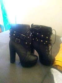 pair of women's studded black leather booties Baltimore, 21217