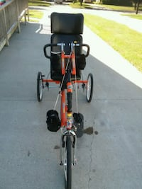 black and red bicycle with training wheels Minneapolis