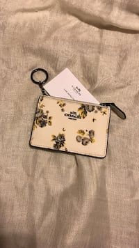 white and gray Coach floral coin purse Elkridge, 21075