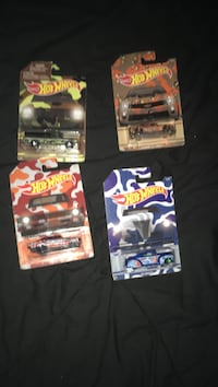 four assorted die-cast cars