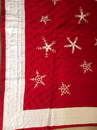 red and white snowflake quilt