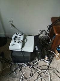 white Xbox One console with two controllers Cedar Rapids
