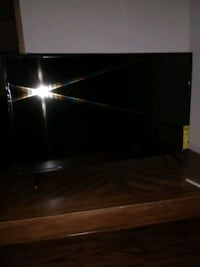 black flat screen TV with remote Annandale, 22003