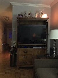 flat screen TV and brown wooden TV hutch Mississauga, L5M 6P8