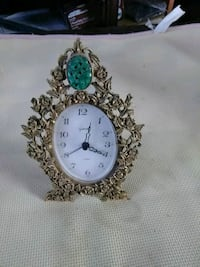 round white analog clock white and green flor