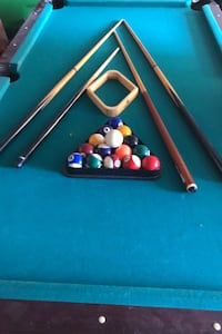 Pool table 4x7 balls and cue sticks price is firm
