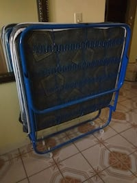 blue and black luggage bag Surrey