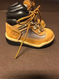 pair of brown-and-black leather work boots 43 km