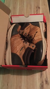 pair of brown-and-white Nike basketball shoes with box