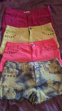 two pairs of blue and pink denim shorts
