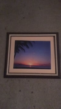 Brown wooden framed photo of a sunset 2183 mi