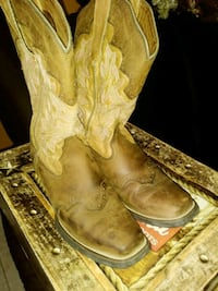 pair of brown leather cowboy boots 1292 mi