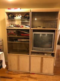 flat screen television with brown wooden TV hutch 60$ with TV Montréal, H3G 1B7