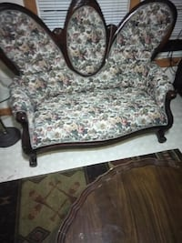 brown and white floral fabric sofa