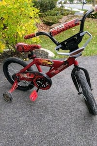 Boy's bike with training wheels
