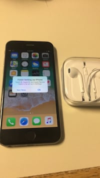 space gray iPhone 6 with EarPods and case 334 mi