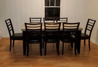 Marble Table With 8 Black Leather Chairs