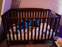 baby's brown wooden crib, changing table, $50Amora Mobile, 36606