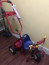 toddler's red and blue Radio Flyer trike 226 mi