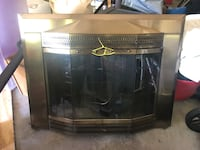 Brass fireplace screen with beveled glass doors
