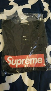 black and red Supreme crew-neck shirt