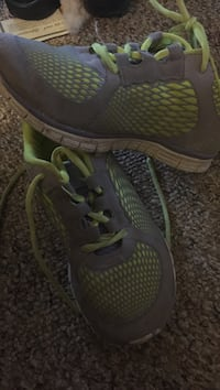 pair of green-and-gray running shoes 204 km