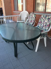 Patio Table with 4 plastic white chairs, 4 cushions, umbrella too...